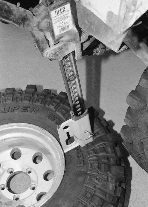 With the Jack-Mate flipped upside down, we were able to use it as a tire machine to pop off a bead. We were a little worried about punching a hole in our tire, so we feel the factory flat baseplate is better suited for this duty.