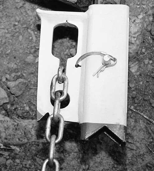 The attachment has provisions for 3/8-inch chain and a hole for a 1-inch D-ring. Both have a multitude of uses.