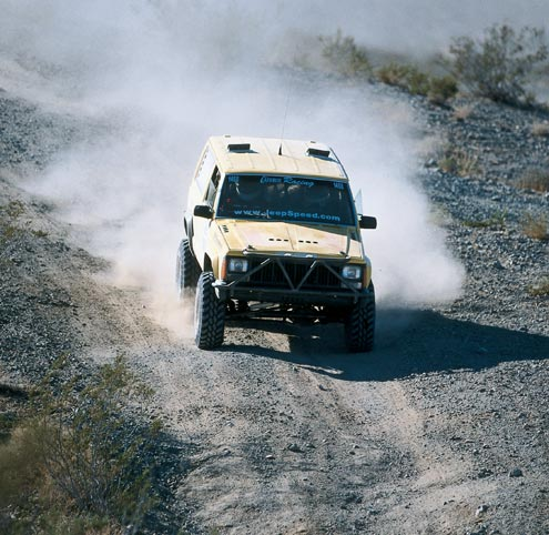 Casey Currie and the rest of the kids from Currie Enterprises race a two-door Cherokee with a heavily trussed Dana 44 up front and a Ford 9-inch out back. The rules require the rest of the drivetrain to remain all-Jeep.
