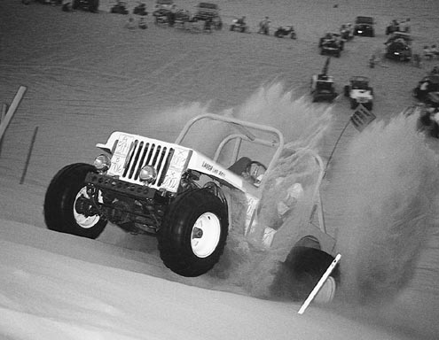 Sand is a whole other ball game. Wheelspin is needed to keep your tires floating across the surface. Lower gears are also needed to keep the engine in its powerband, but too low a gear will cause the engine to wind out before the wheels can get up to the speed they need to be.