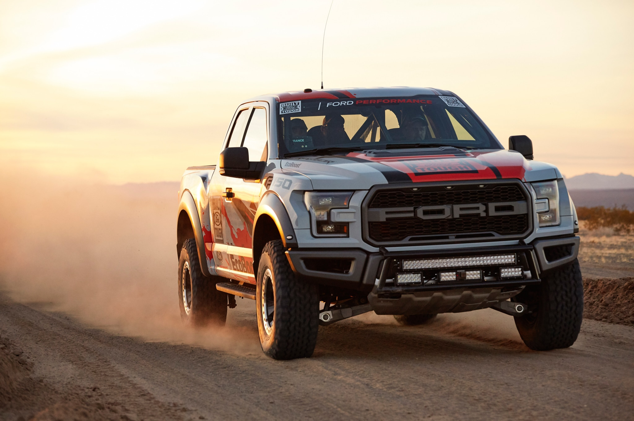 2017 Ford F 150 Raptor Baja race truck front three quarter in motion 02