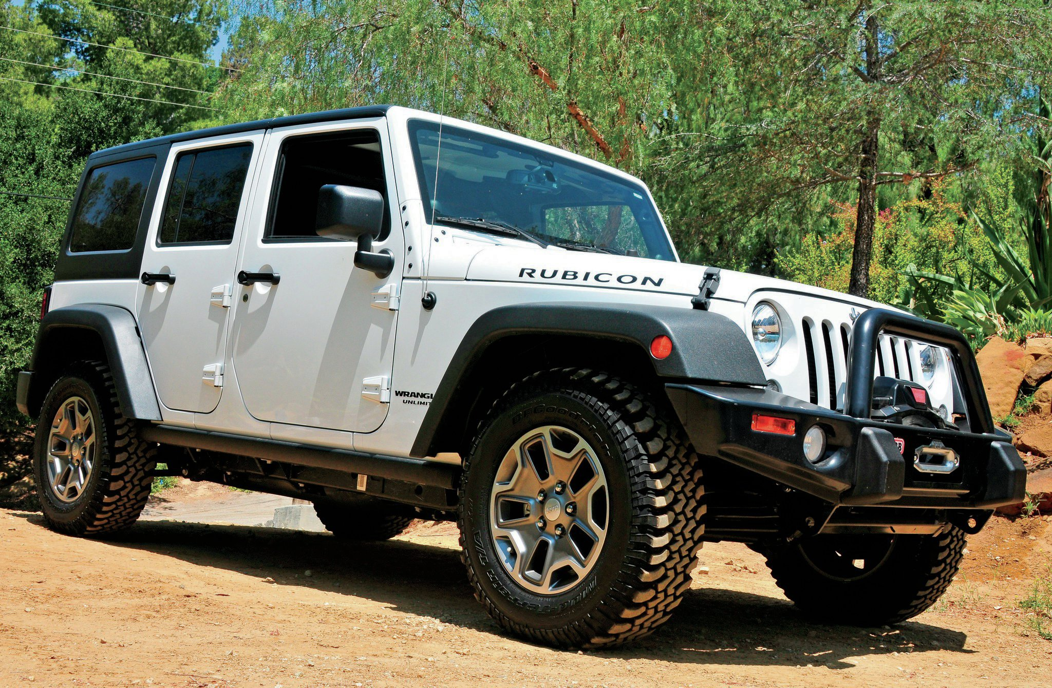 Starting with a well-equipped four-door JK Rubicon, there wasn't much else that needed to be done. A dealer had already added an ARB bumper and Warn winch, and stock 4:1 transfer case gears and 4.10:1 axle gears gave a great crawl ratio. Selectable lockers front and rear, along with a disconnecting sway bar, also help out tremendously in the dirt. Without getting too radical, just about the only things left to do was to add larger mud-terrains and give this JK a few more inches of height. With the kit at the house, we quickly knocked out the first of a three-day project. With two friends, three of us tore down the front end in a matter of minutes, in the dirt, with a floor jack and a couple jackstands.