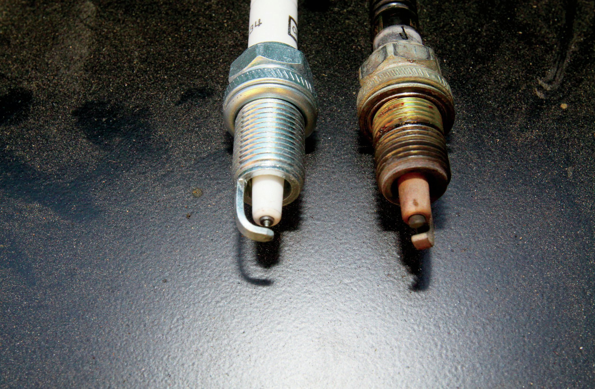 Since we had the new parts from DUI, we decided to go ahead and swap plugs too. While we do like the fancier plugs, when we use a DUI coil, we always just go with the regular Champion plugs (especially in a Jeep with 258,000 miles).