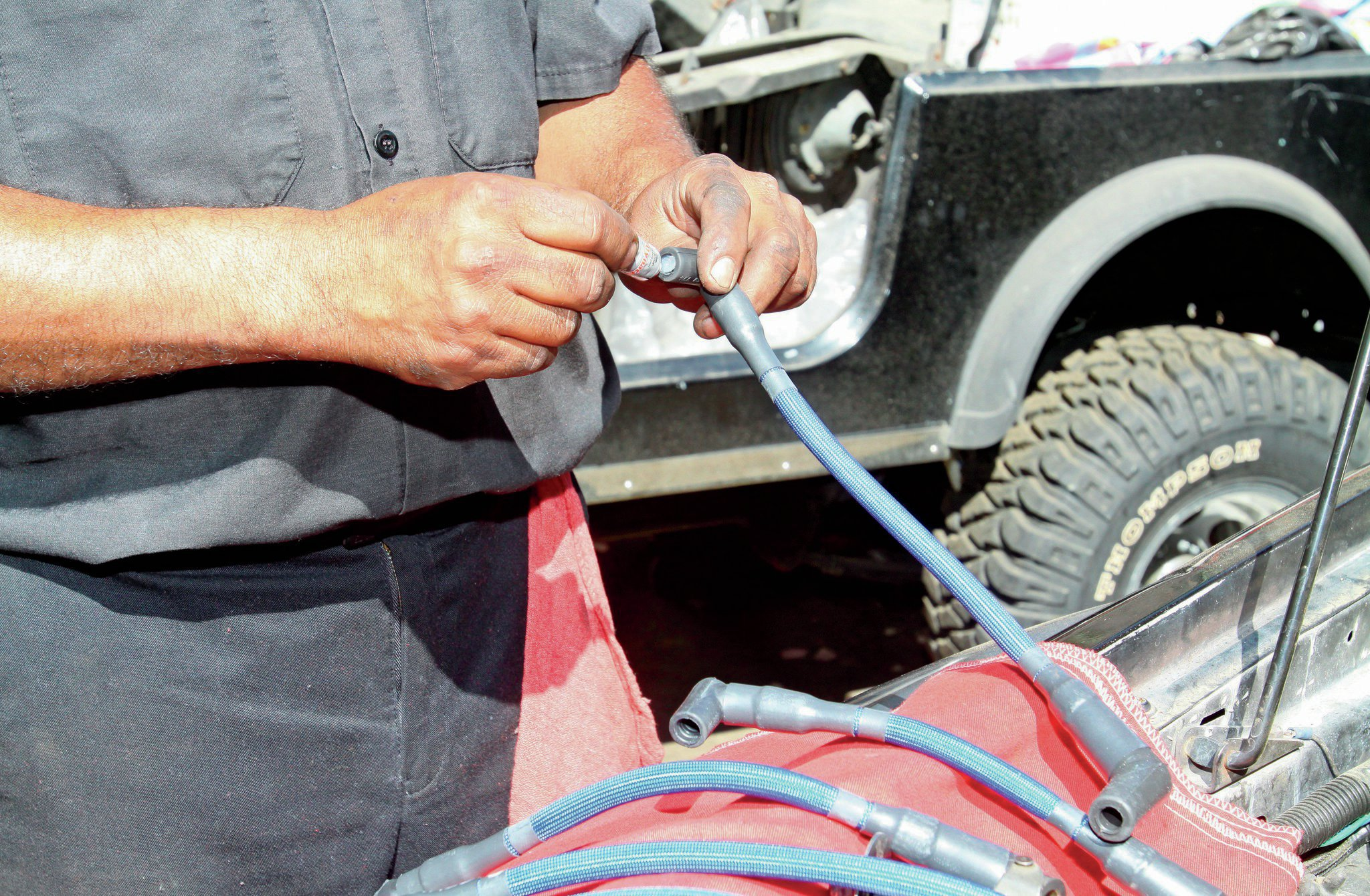 The plug wires come from DUI with dielectric grease. While it is true it helps terminals not corrode, it doesn't actually decrease resistance. Its primary purpose is to make it so that the wire ends will come off the plugs or cap if needed. It's much like anti-seize for electrical parts.