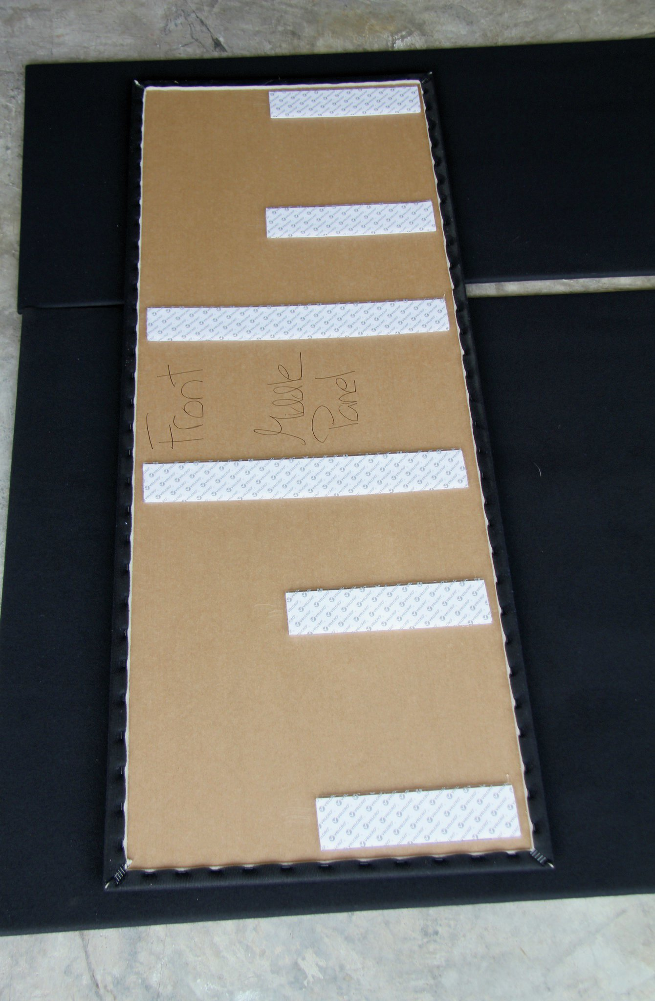 Each panel is clearly marked and fit with Velcro-brand strips with adhesive backing. Using staples to secure the fabric cover over the foam and particleboard base, the panels were extremely light but not flimsy in the least.