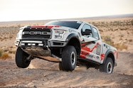 2017 Ford F 150 Raptor Baja race truck front three quarter in motion